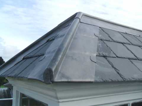 TM Building in Fleet Hampshire - re-slate & re-tile roof
